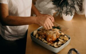 Traditional Irish Winter Recipes, woman cooking chicken