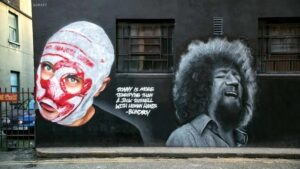 Mural of 'Blindboy' and Luke Kelly painted on the walls of Hangar nightclub in St Andrew's Lane by Subset