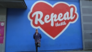 Maser's with 'Repeal The 8th' mural on the walls of the Project Arts Centre, located on East Essex Street.